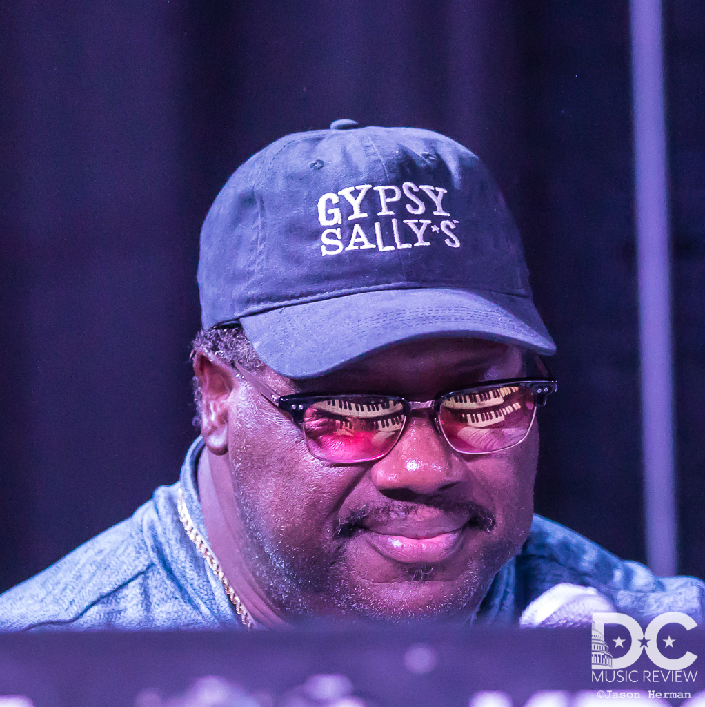 Melvin Seals sporting his Gypsy Sally's hat... but pay attention to the selection his glasses.