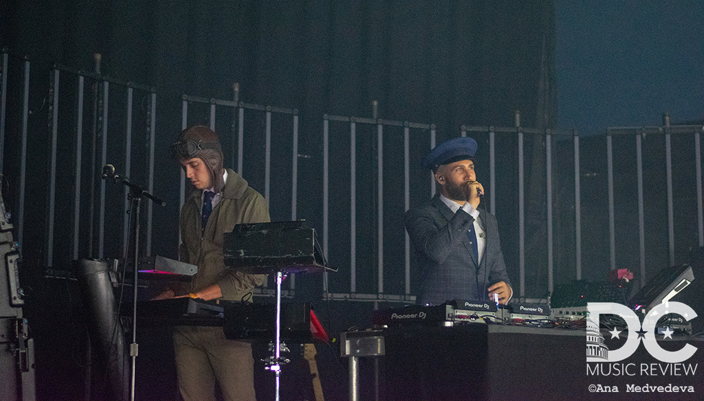 Both members of Flight Facilities illuminated on stage