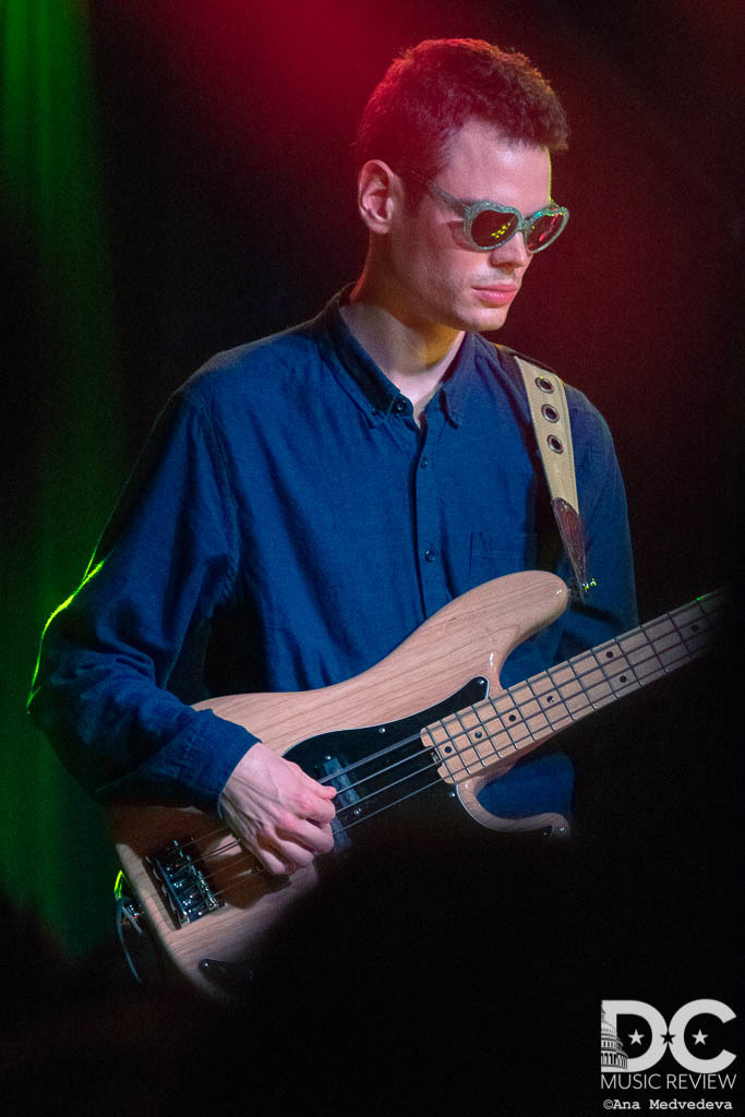 Alex's bass player wearing the glasses thrown onto the stage