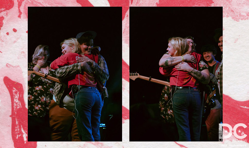 Lindsey Jordan hugging the recently engaged couple on stage